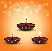Diwali poster. Burning diya on orange bokeh background