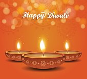Diwali poster on orange background with burning diya