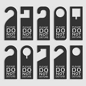 istock Do not disturb door hanger set. Vector 1288956450