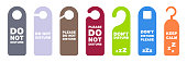 istock Do not disturb tag. Don't disturb banner in hotel. Please do not disturb collection. Hanging label in hotel. Private time message. Warning symbol on door. Colorful privacy tag set. Vector illustration. EPS 10. 1297268724