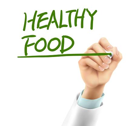 doctor writing healthy food words