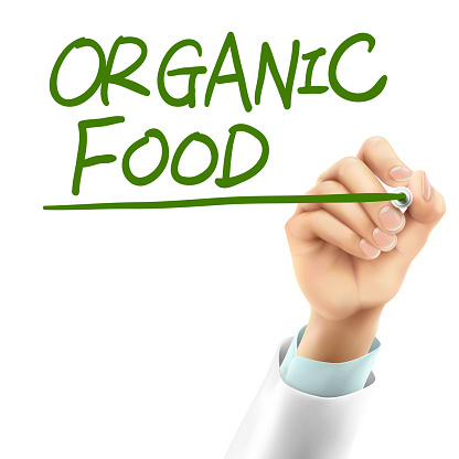doctor writing organic food words