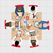 Doctors and Medical Professionals with diversity and equality Meeting around Boardroom Table - stethoscope and computers
