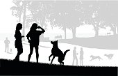 Silhouette vector illustration or two girls playing ball with their dog at the city park