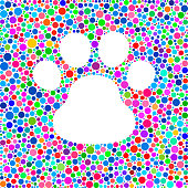 Dog Paw Icon on Color Circle Background Pattern on color circle pattern background. The circles are vibrant and the icon shape is formed as a negative space on white background.  The circles are flat and vary in size and shades of color. Icon download includes vector graphic and jpg file.