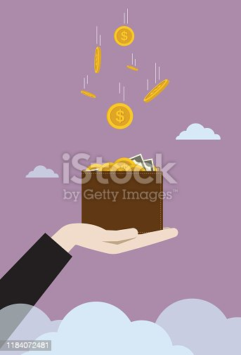 istock US dollar coin falling to businessman wallet 1184072481