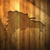 Dominican Republic Map on lit Wooden Background