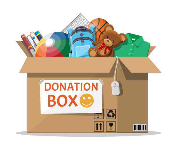donation box full of toys, books, clothes, devices - zabawka stock illustrations