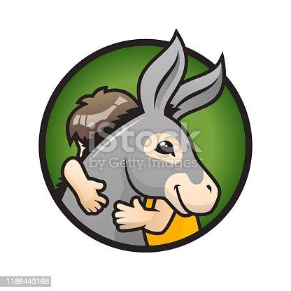 istock Donkey with a kid. Child hugs a cute donkey 1186443168