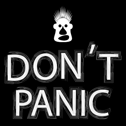 Don't panic. White funny face and text on black background.