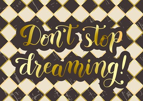 Don't stop dreaming in golden gradient on brown ivory white background stylized as chessboard