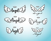 Doodle flying angel wings with halo. Sketch angelic wings. Freedom and religious tattoo vector design isolated on white background.