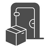 Door and cardboard package solid icon, Logistics delivery symbol, parcel box delivery to the door vector sign on white background, contactless delivery icon in glyph style. Vector graphics