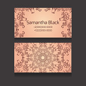 Double-sided  business card with a tribal floral pattern for your business