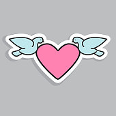 Doves flying with heart decorative element.