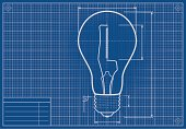Drafted Light Bulb On Blueprint Paper