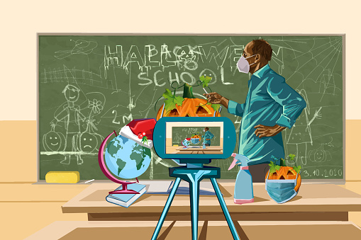 Drawing of a Halloween pumpkin with a face mask on the blackboard