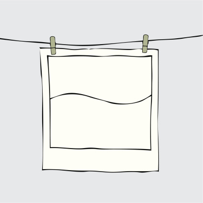 A drawing of a photo being hung to dry