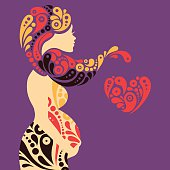 Drawing of silhouette of a pregnant woman made of patterns