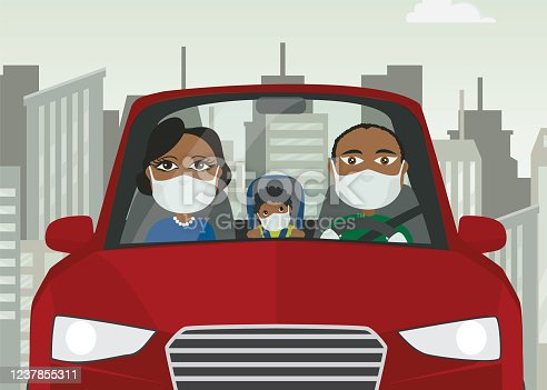 istock Driving car family male female baby black with mask white gloves holding steering wheel in blue car with city in the background 1237855311