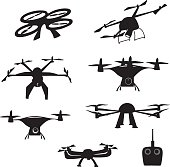 A vector silhouette illustration of flying dones in various positions with a remote control.