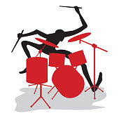 A drummer carries out a solo on drums