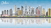 Dubai UAE Skyline with Gray Buildings, Blue Sky and Reflections.