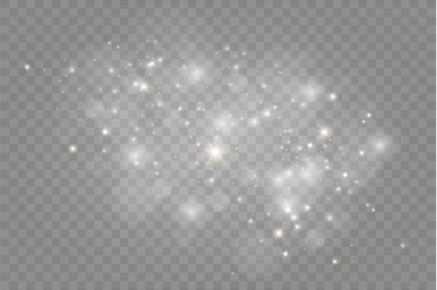 dust on a transparent background.bright stars.the glow lighting effect - glowing stock illustrations