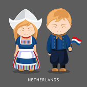 Dutches in national dress with a flag.