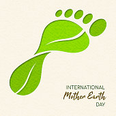 International Earth Day illustration of carbon footprint concept. Green papercut leaves making foot shape for environment care.