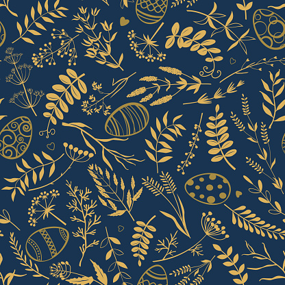 Easter background. Easter eggs, twigs, herbs and flowers on dark blue background.
