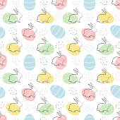Easter background. Seamless abstract pattern with Easter bunnies and eggs on a white background. Vector illustration