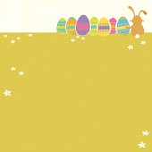 Vector illustration of a grassy field with a bunny with Easter eggs sitting and enjoying the view.