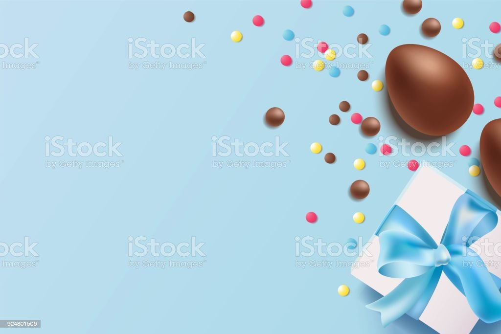Easter background with chocolate eggs gift box and candy on blue easter background with chocolate eggs gift box and candy on blue background royalty negle Gallery