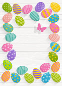 Easter background with colorful eggs on Wood background