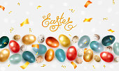 Easter background with painted realistic chicken and quail eggs