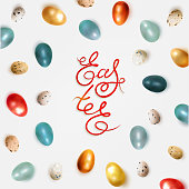 Easter banner with realistic chicken and quail dyed Easter eggs