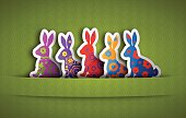 Easter Bunnies with green background. High Resolution JPG,CS5 AI and Illustrator EPS 10 (with shadow effects) included. Each element is named,grouped and layered separately.