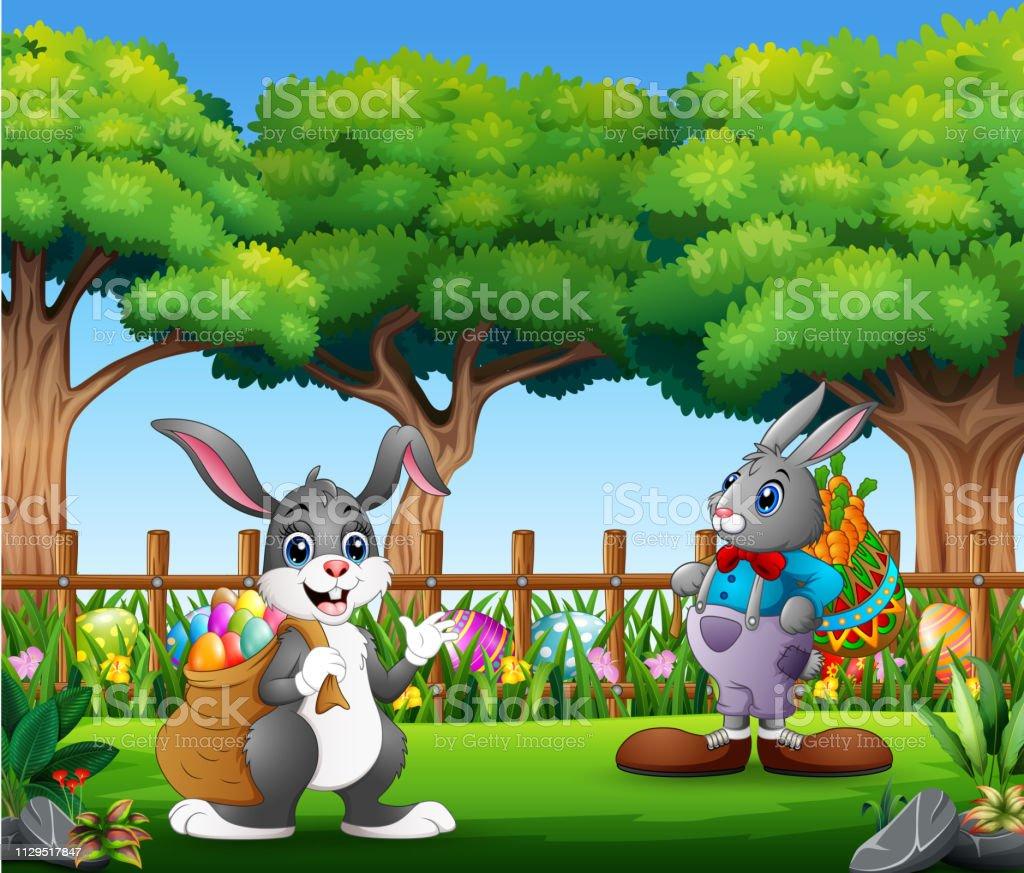Ei Voor In De Tuin.Pasen Konijntjes En Kleurrijke Ei Op De Tuin Stockvectorkunst En