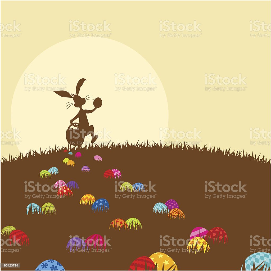 Easter bunny and easteregg painted in chocolate color vector art illustration
