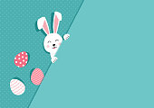 Easter bunny and eggs greeting card. Paper rabbit on polka dot turquoise background. Vector illustration