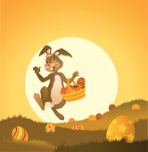 Image of an Easter Rabbit happily skipping through the grass in brilliant sunlight.