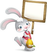 cartoon illustration of cute easter bunny holding wood sign for copy space