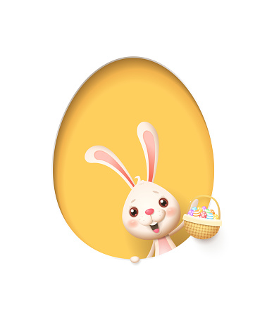 Easter bunny in a egg shaped yellow hole with a basket filled with decorated eggs - isolated on white