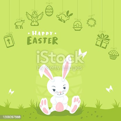istock Easter bunny on green grass 1209267568