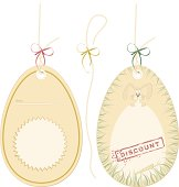 Easter bunny holding egg with space for your price, text or design. This is detailed illustration of two price/gift tags suitable for holiday sales, especially for Easter. The source documents (AI and EPS) already has ropes for both tags, as well as bows in tree different colors (red, green and gold). All items are set on different layers and with just a few clicks you can have few different theme variations. Details: