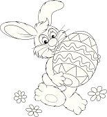 Funny rabbit friendly smiling and carrying a colorfully painted Easter egg, black and white outline illustration for a coloring book