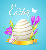 Easter card with egg and violet crocuses on a blue background. EPS 10 file, contains transparencies.