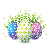 Easter color decorated eggs on white background with green blades of grass