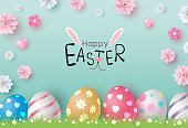 istock Easter day design of eggs and flowers on color paper background vector illustration 1130235324